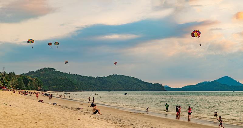 Paragliders at sunset on Pantai Tengah,in Langkawi, Malaysia